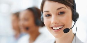 Closeup of a beautiful business customer service woman smiling